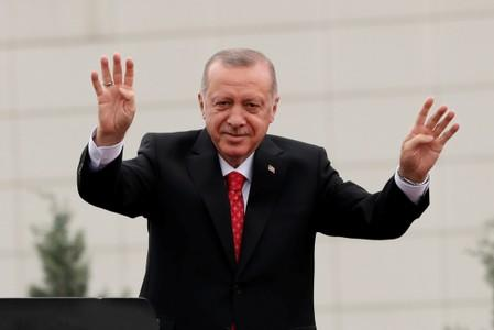FILE PHOTO: Turkish President Erdogan greets supporters during a ceremony in Istanbul