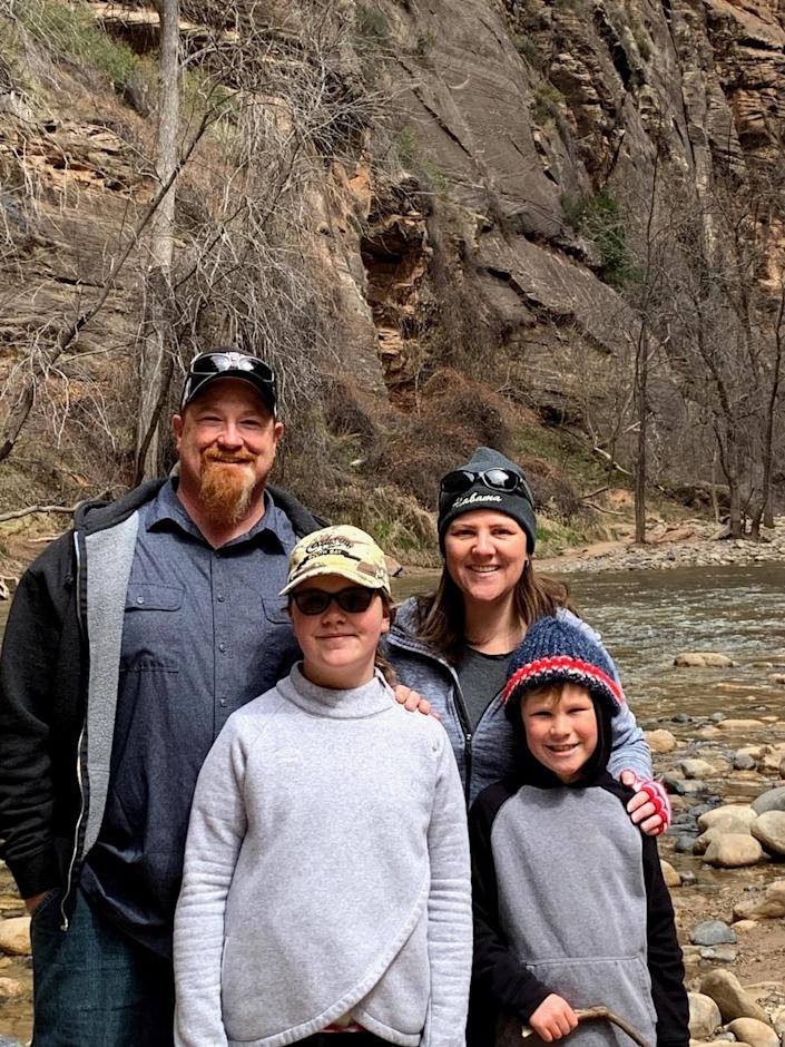 """Charles Brian Margeson, his daughter Alexis, wife Jaime and son Robert of Torrance, California during a """"COVID trip"""" to Zion National Park during spring break in April 2020. He sued Ford for fraud after the company sold him a 6.0L diesel engine with known defects used in his F-350 and won on appeal."""