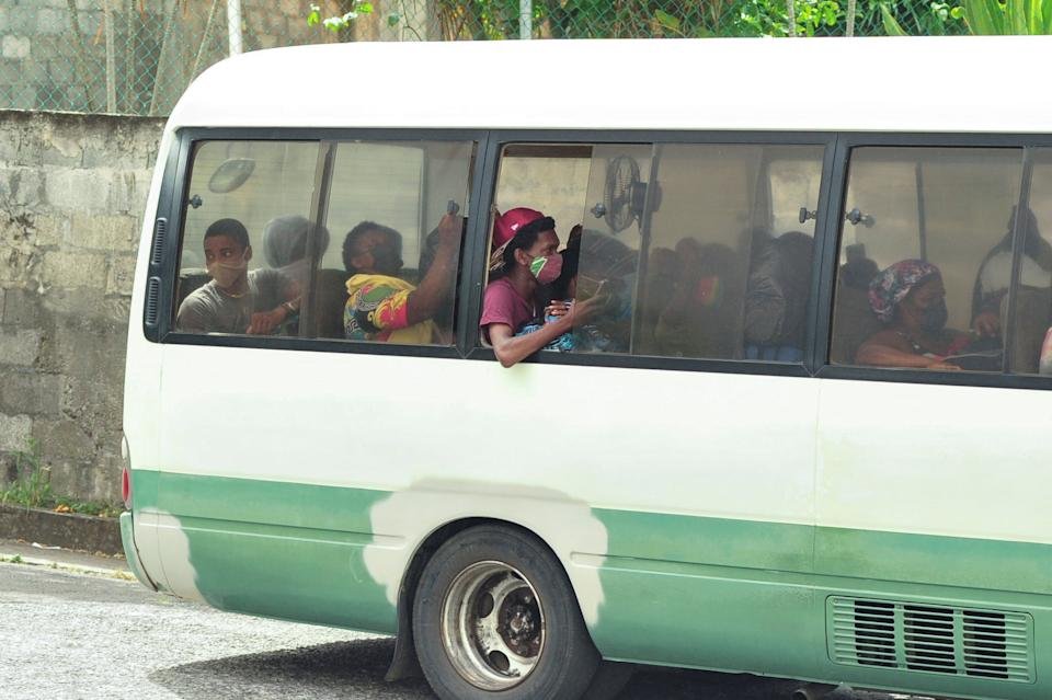 Evacuees travel by bus as they leave a village following the eruption of La Soufriere volcano on the eastern Caribbean island of St. Vincent April 9, 2021.  REUTERS/Robertson S. Henry