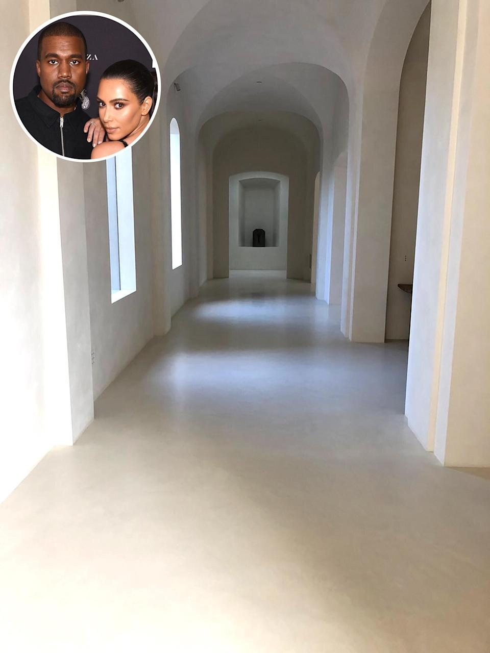 """Kanye West got in a bit of trouble with his wife Kim Kardashian West, when he shared<a href=""""https://people.com/home/kanye-west-posts-photos-inside-20m-house-as-kim-responds-we-had-a-rule-to-not-show-our-home/"""" rel=""""nofollow noopener"""" target=""""_blank"""" data-ylk=""""slk:images of the interior of their Hidden Hills home"""" class=""""link rapid-noclick-resp""""> images of the interior of their Hidden Hills home</a> on Twitter in April 2018. """"Ummm babe. We had a rule to not show our home on social media! Soooo can we now allow KUWTK filming in the home?"""" she tweeted. She <a href=""""https://twitter.com/KimKardashian/status/989178154953592832"""" rel=""""nofollow noopener"""" target=""""_blank"""" data-ylk=""""slk:later clarified"""" class=""""link rapid-noclick-resp"""">later clarified</a> that her message was meant to be a joke. Since then, the Wests have seemingly been less strict about showing off their mansion to the world. Here are the best snaps they've shared inside their <a href=""""https://people.com/home/kanye-west-posts-photos-inside-20m-house-as-kim-responds-we-had-a-rule-to-not-show-our-home/"""" rel=""""nofollow noopener"""" target=""""_blank"""" data-ylk=""""slk:$60 million family home"""" class=""""link rapid-noclick-resp"""">$60 million family home</a>."""