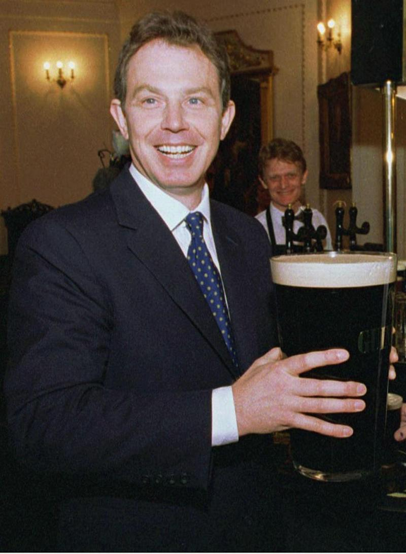 Labour party leader Tony Blair holds eight pints of Guinness at the London Press Club lunch which he attended April 22. Blair said the country is sliding down the scale produced by the World Prosperity League to 21st place as a result of the economic policies of 18 years of Conservative governments. BRITAIN ELECTION