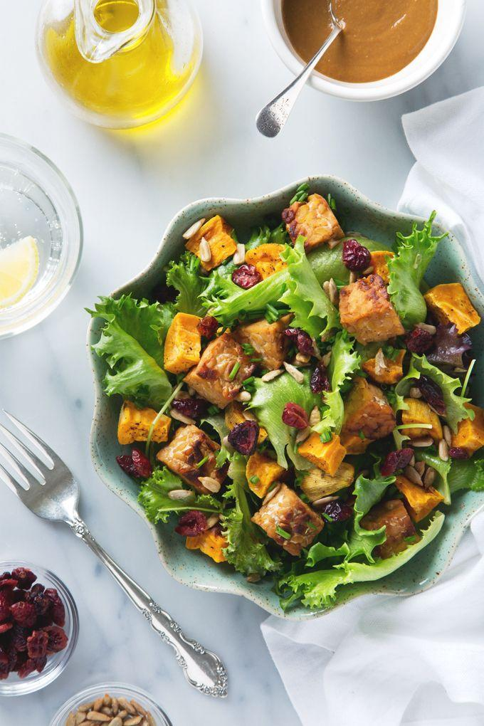 """<p>Finish off this <a href=""""https://www.countryliving.com/food-drinks/g4710/thanksgiving-salad/"""" rel=""""nofollow noopener"""" target=""""_blank"""" data-ylk=""""slk:Thanksgiving salad"""" class=""""link rapid-noclick-resp"""">Thanksgiving salad</a> with a mix of toppings. This blogger recommends dried cranberry seeds, sunflower seeds, or pumpkin seeds.</p><p><strong>Get the recipe at <a href=""""http://www.picklesnhoney.com/sweet-potato-salad-tempeh/"""" rel=""""nofollow noopener"""" target=""""_blank"""" data-ylk=""""slk:Pickles & Honey"""" class=""""link rapid-noclick-resp"""">Pickles & Honey</a>.</strong> </p>"""