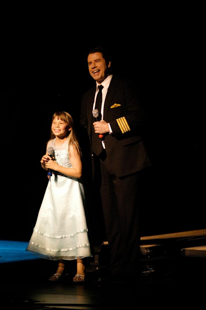 Actor John Travolta and Bindi Irwin stand on stage for Austrailia Plays Broadway during the opening night celebration for G'DAY USA: Australia Week at Jazz Lincoln Center January 22, 2008 in New York City. (Photo by Steven Henry/Getty Images)
