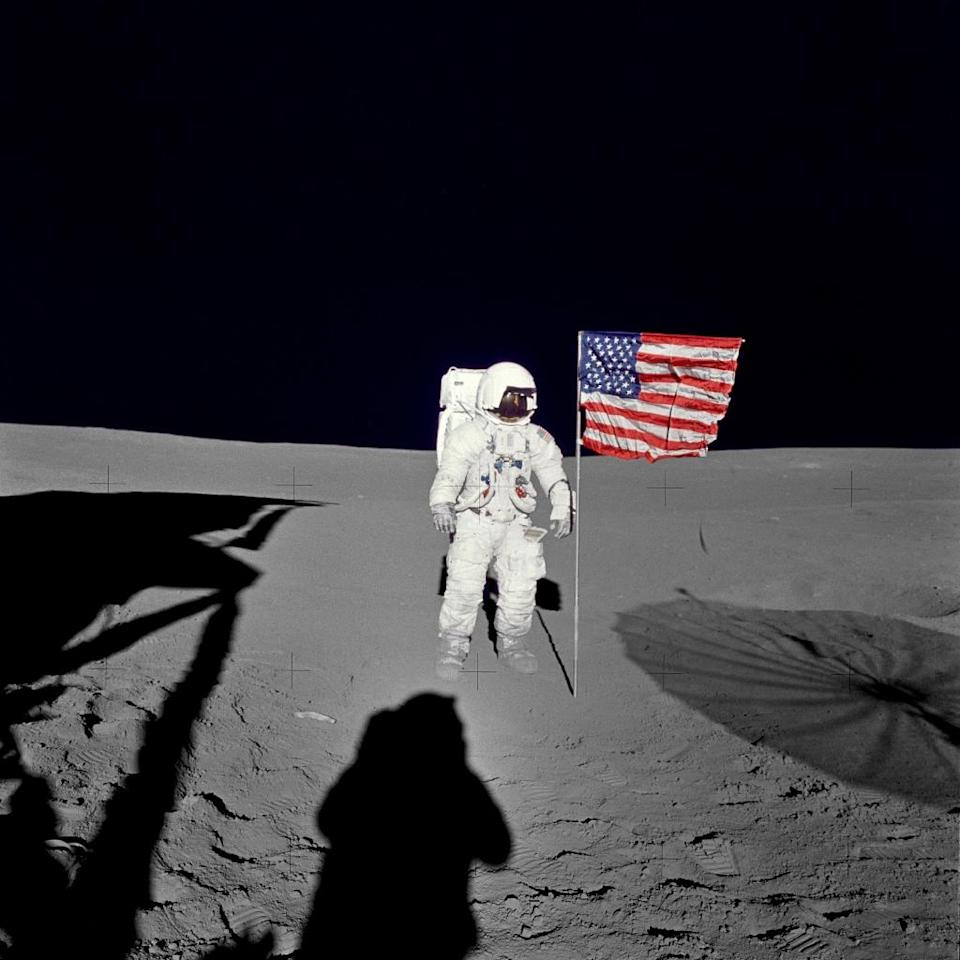 This undated NASA image obtained on February 5, 2016 shows astronaut Edgar D. Mitchell, Apollo 14 lunar module pilot, standing by the deployed U.S. flag on the lunar surface during the mission's first spacewalk (AFP Photo/)