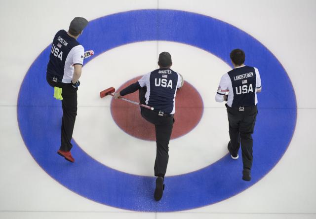 United States skip John Shuster, center, makes a shot as, second, Matt Hamilton and lead, John Landsteiner look on during the 4th draw against Scotland at the men's World Curling Championships in Edmonton, Alberta, Sunday, April 2, 2017. (AP)