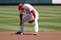 St. Louis Cardinals third baseman Nolan Arenado looks down after dropping a ball hit for a single by Washington Nationals' Juan Soto during the third inning of a baseball game Wednesday, April 14, 2021, in St. Louis. (AP Photo/Jeff Roberson)