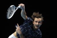 Daniil Medvedev of Russia serves to Diego Schwartzman of Argentina during their singles tennis match at the ATP World Finals tennis tournament at the O2 arena in London, Friday, Nov. 20, 2020. (AP Photo/Frank Augstein)