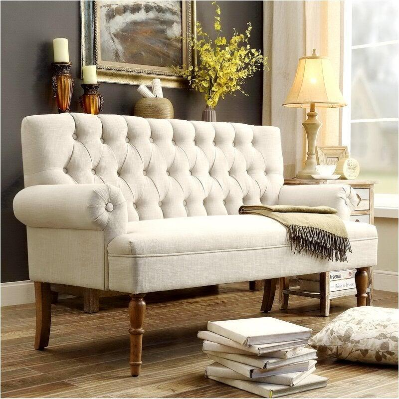 """<h2>Andover Mills Bjorn 59"""" Rolled Arm Settee</h2><br><strong>Deal: 75% off</strong><br>Small scale seating plus cushy foam padding equals the perfect couch for not-so-big apartments. Create an elevated estate parlor inside your studio with this tufted-gray settee made from maple wood and covered in cushioned-linen upholstery.<br><br><em>Shop</em> <a href=""""https://www.wayfair.com/brand/bnd/andover-mills-b30808.html"""" rel=""""nofollow noopener"""" target=""""_blank"""" data-ylk=""""slk:Andover Mills"""" class=""""link rapid-noclick-resp""""><strong><em>Andover Mills</em></strong></a><br><br><strong>Andover Mills</strong> Bjorn 59"""" Rolled Arm Settee, $, available at <a href=""""https://go.skimresources.com/?id=30283X879131&url=https%3A%2F%2Fwww.wayfair.com%2Ffurniture%2Fpdp%2Fandover-mills-bjorn-59-rolled-arm-settee-w000619313.html"""" rel=""""nofollow noopener"""" target=""""_blank"""" data-ylk=""""slk:Wayfair"""" class=""""link rapid-noclick-resp"""">Wayfair</a>"""