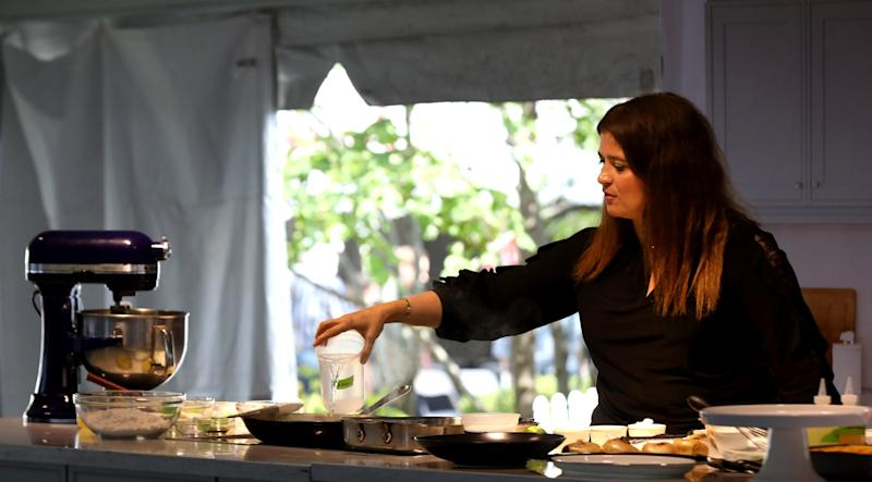 Chef Alex Guarnaschelli adds water to a recipe she was cooking in front of a packed audience inside The Sysco Culinary Stage at the Detroit Free Press Wine + Food Experience held at Cadillac Square in downtown Detroit, Michigan on Saturday, September 14, 2019.