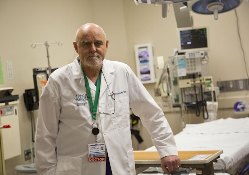 In this Aug. 8, 2012 photo, Dr. Stephen W. Hargarten poses for a photo in a trauma room at Froedtert & Medical College of Wisconsin's emergency department in Milwaukee. Hargarten helped many of the victims of Sunday's shooting at the Sikh Temple of Wisconsin. (AP Photo/Jeffrey Phelps)