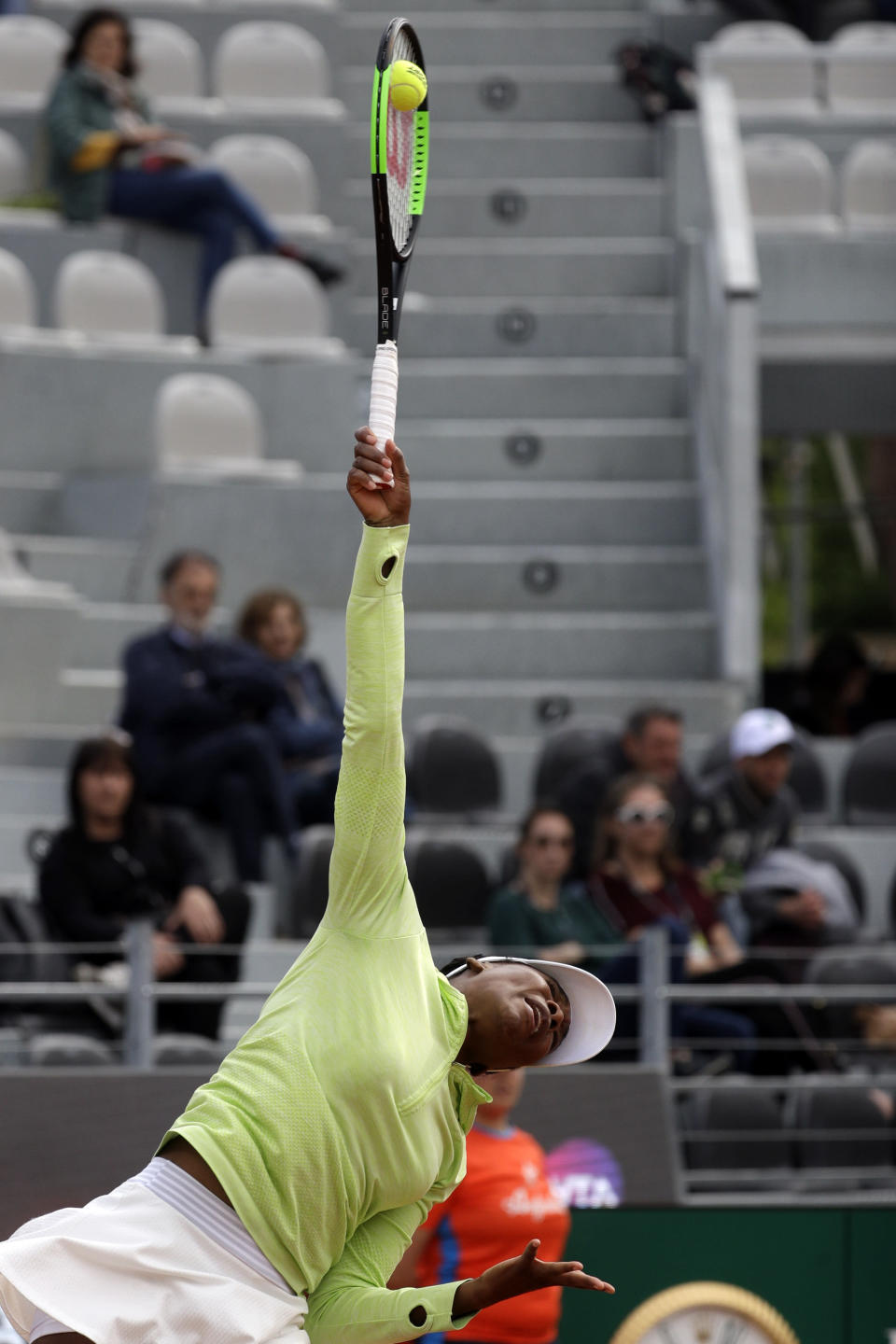 Venus Williams, of the United States, serves the ball during her match against Belgium's Elise Mertens at the Italian Open tennis tournament, in Rome, Monday, May, 13, 2019. (AP Photo/Gregorio Borgia)