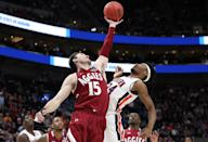<p>Ivan Aurrecoechea #15 of the New Mexico State Aggies and Anfernee McLemore #24 of the Auburn Tigers battle for the ball during the first half in the first round of the 2019 NCAA Men's Basketball Tournament at Vivint Smart Home Arena on March 21, 2019 in Salt Lake City, Utah. (Photo by Patrick Smith/Getty Images) </p>
