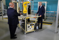 President Joe Biden listens during a tour of the Cuyahoga Community College Manufacturing Technology Center, Thursday, May 27, 2021, in Cleveland. (AP Photo/Evan Vucci)
