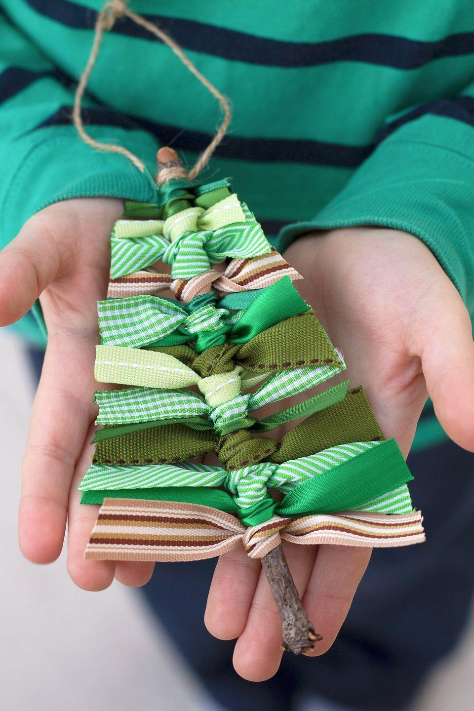 """<p>Pair leftover ribbon or fabric scraps with some twine and a twig sourced from your yard for this easy Christmas ornament. </p><p><strong>Get the tutorial at <a href=""""https://www.firefliesandmudpies.com/scrap-ribbon-tree-ornaments/"""" rel=""""nofollow noopener"""" target=""""_blank"""" data-ylk=""""slk:Fireflies and Mud Pies"""" class=""""link rapid-noclick-resp"""">Fireflies and Mud Pies</a>.</strong></p><p><a class=""""link rapid-noclick-resp"""" href=""""https://www.amazon.com/Grosgrain-Wrapping-Accessories-Crafting-GG-Green/dp/B00798T3O0/?tag=syn-yahoo-20&ascsubtag=%5Bartid%7C10050.g.1070%5Bsrc%7Cyahoo-us"""" rel=""""nofollow noopener"""" target=""""_blank"""" data-ylk=""""slk:SHOP GREEN RIBBON SET"""">SHOP GREEN RIBBON SET</a></p>"""