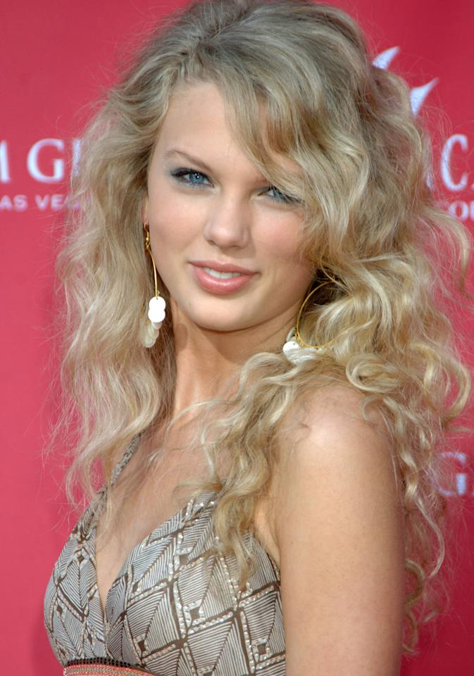 <p>A fresh-faced Swift arrived at the Academy of Country Music Awards back in 2006, the same year her debut album was released. Her now-famous curls were parted to the side, and she went with a youthful, shimmery blue shadow to bring out her eyes. </p>