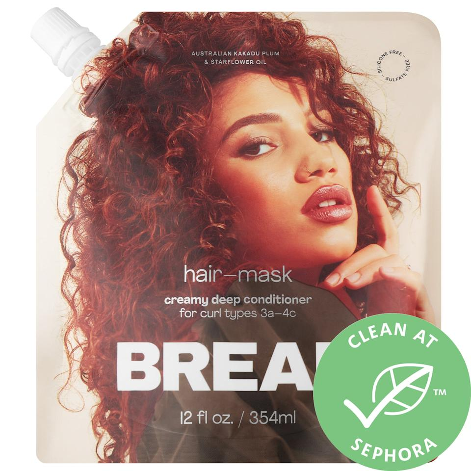 """<p>I'm already calling it: This <product href=""""https://www.sephora.com/product/bread-beauty-hair-mask-creamy-deep-conditioner-P460550?icid2=products%20grid:p460550"""" target=""""_blank"""" class=""""ga-track"""" data-ga-category=""""Related"""" data-ga-label=""""https://www.sephora.com/product/bread-beauty-hair-mask-creamy-deep-conditioner-P460550?icid2=products%20grid:p460550"""" data-ga-action=""""In-Line Links"""">Bread Beauty Supply Hair Mask Creamy Deep Conditioner</product> ($28) is the styling product I'm most thankful for in 2020. It's not only very velvety to touch but, once I applied the mask, my curls drank it right up. I separated my hair into sections while applying, made four little <a href=""""https://www.popsugar.com/beauty/history-black-hairstyles-cultural-appropriation-47659501"""" class=""""ga-track"""" data-ga-category=""""Related"""" data-ga-label=""""https://www.popsugar.com/beauty/history-black-hairstyles-cultural-appropriation-47659501"""" data-ga-action=""""In-Line Links"""">bantu knots</a>, and then hopped out of the shower so it could continue to work its magic for 10 minutes.<br><br> While I waited, moisturizing ingredients like kakadu plum and starflower oil were working to both strengthen my follicles and boost my scalp and hair's collagen and elastin. Sure, that means I was getting a treat on the inside, but I have never been able to detangle my curly hair as easily as I could after letting this product soak in and have never such little hair on my wide-toothed comb when I finished. My hair also felt softer and more slippery, and I knew this mask had found a home in my permanent self-care rotation.</p>"""