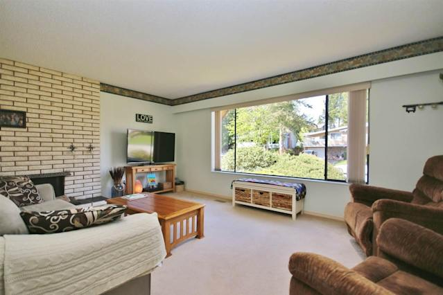 <p><span>11644 64B Avenue, Delta, B.C.</span><br>This 1,947-square-foot family home is described as clean and well cared for.<br>(Photo: Zoocasa) </p>