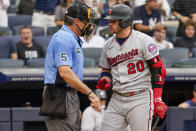 Minnesota Twins' Josh Donaldson (20) argues with umpire Angel Hernandez (5) after striking out in the fifth inning of a baseball game against the New York Yankees, Saturday, Aug. 21, 2021, in New York. (AP Photo/Mary Altaffer)