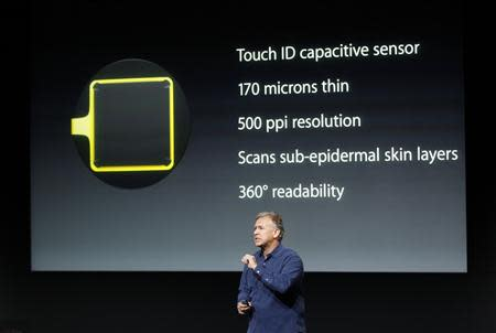 Phil Schiller, senior vice president of worldwide marketing for Apple Inc, talks about the new iPhone 5S Touch ID fingerprint recognition feature at Apple Inc's media event in Cupertino, California September 10, 2013. REUTERS/Stephen Lam
