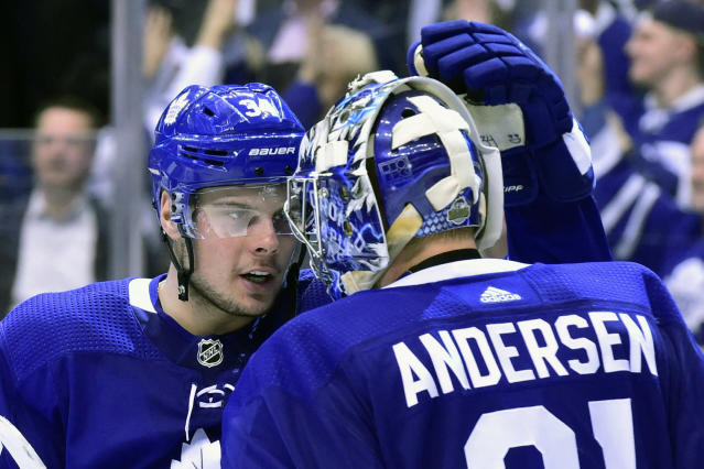 Toronto Maple Leafs center Auston Matthews (34) and goaltender Frederik Andersen (31) celebrate their win over the Boston Bruins in NHL round one playoff hockey action in Toronto on Monday, April 23, 2018. (Frank Gunn/The Canadian Press via AP)