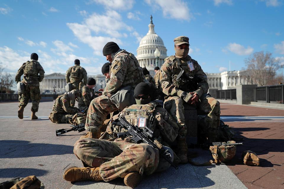 <p>National Guard troops gather in front of the US Capitol in Washington.</p> (Reuters)