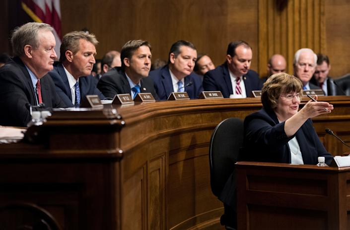 Rachel Mitchell, counsel for Senate Judiciary Committee Republicans, questions Christine Blasey Ford as Republican senators Mike Crapo, Jeff Flake, Ben Sasse, Ted Cruz, Mike Lee and John Cornyn listen during the Senate Judiciary Committee hearing.