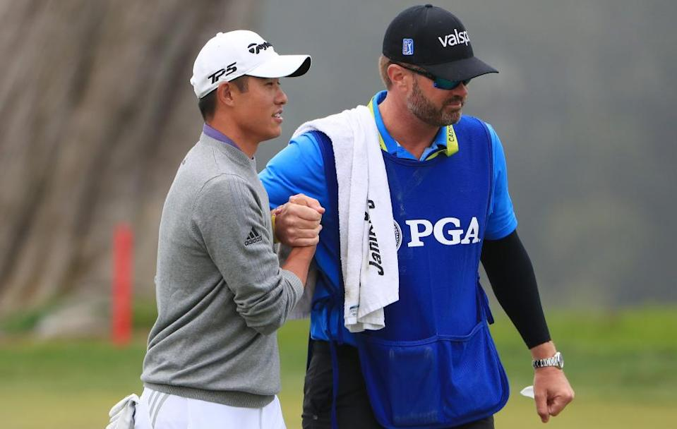 Collin Morikawa celebrates with his caddie JJ Jakovac after holing his putt on the 18th during the final round at Harding Park.