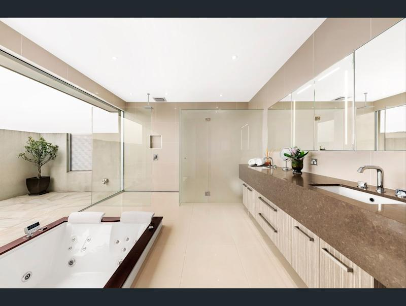 The master bedroom comes with an ensuite with a spa bath. Image: Ray White