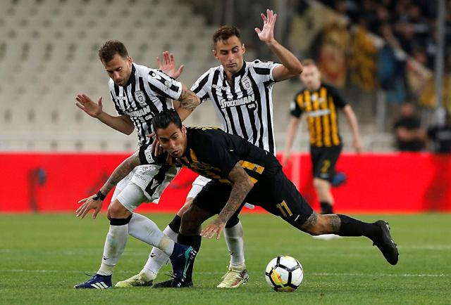 Soccer Football - Greek Cup Final - AEK Athens vs PAOK Salonika - Athens Olympic Stadium, Athens, Greece - May 12, 2018 PAOK Salonika's Mauricio in action with AEK's Sergio Araujo REUTERS/Costas Baltas