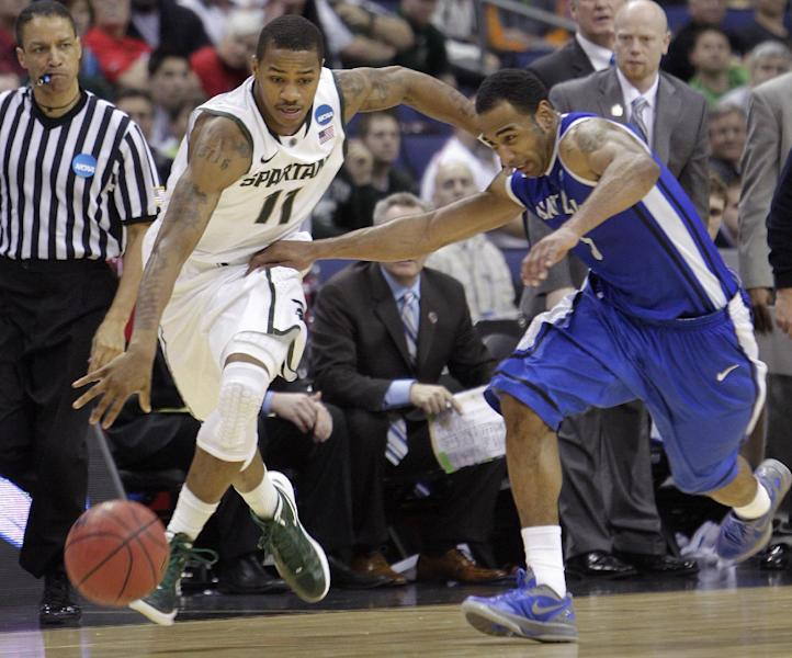 Michigan State's Keith Appling, left, brings the ball up as Saint Louis' Kwamain Mitchell fouls him to stop the clock during the second half of an NCAA men's college basketball tournament third-round game Sunday, March 18, 2012, in Columbus, Ohio. Michigan State won 65-61. (AP Photo/Jay LaPrete)