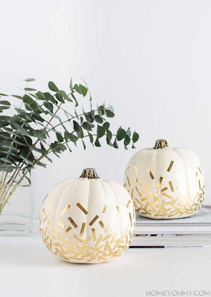 """<p>Use Washi tape to create these sophisticated pumpkins, which look especially stunning in front of a clean, white wall.<br></p><p><strong><em>Get the tutorial from <a href=""""http://www.homeyohmy.com/diy-confetti-pumpkins/"""" rel=""""nofollow noopener"""" target=""""_blank"""" data-ylk=""""slk:Homey Oh My"""" class=""""link rapid-noclick-resp"""">Homey Oh My</a>.</em> </strong></p>"""