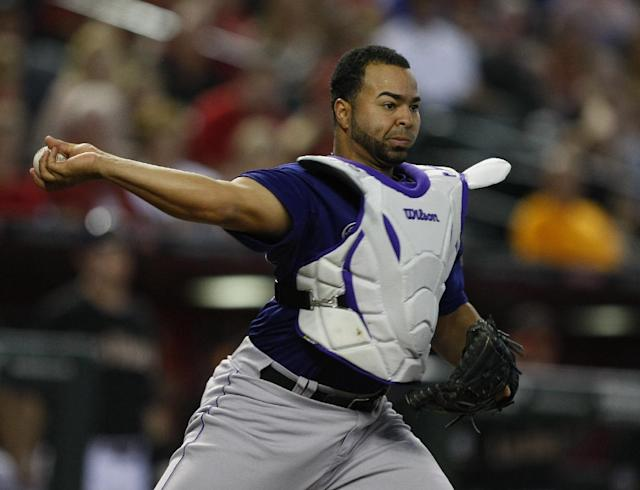 Colorado Rockies catcher Wilin Rosario throws to first base for the out against the Arizona Diamondbacks in the first inning during a baseball game on Saturday, Sept. 14, 2013, in Phoenix. (AP Photo/Rick Scuteri)