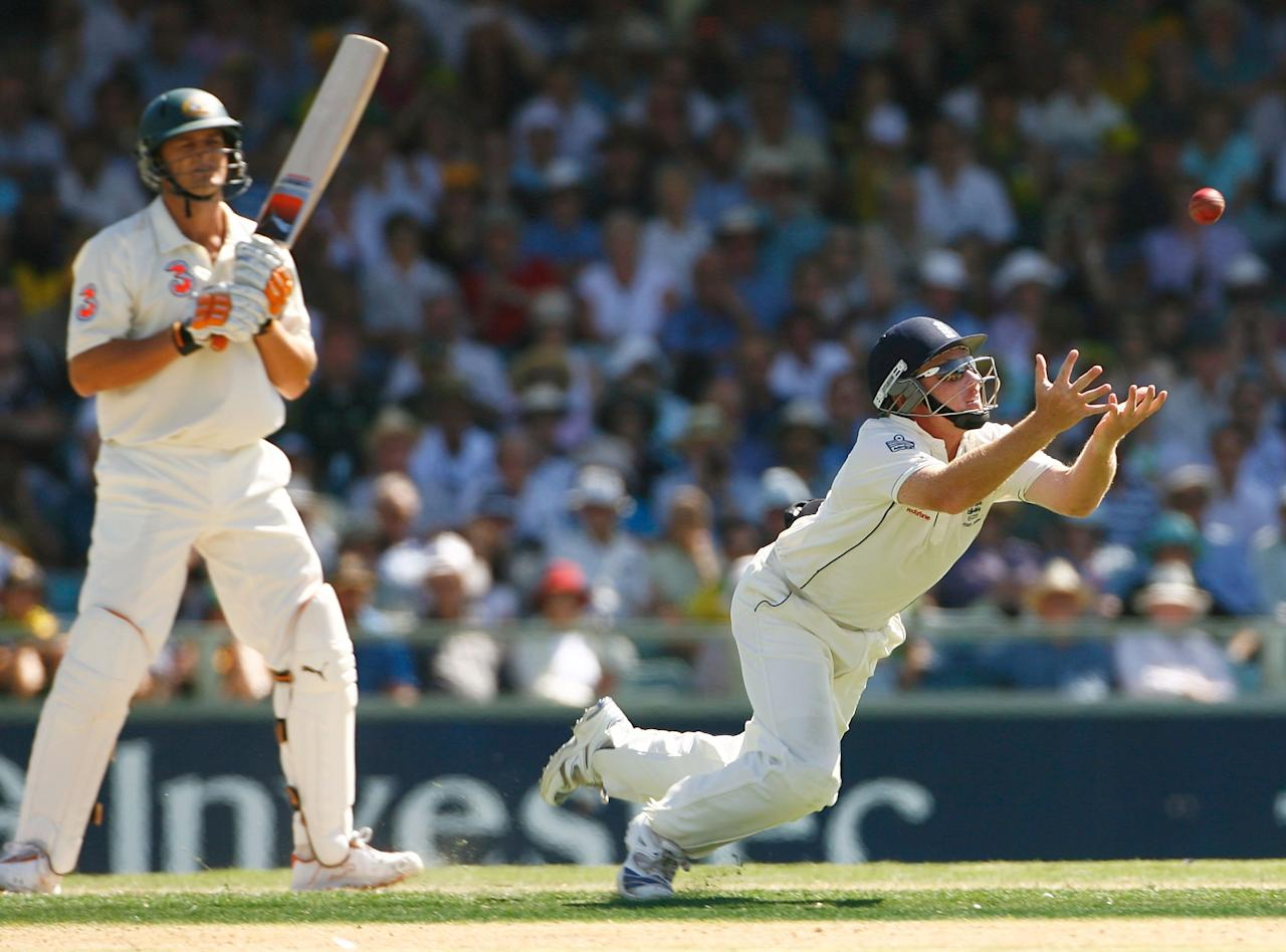 PERTH, AUSTRALIA - DECEMBER 14:  Adam Gilchrist of Australia looks on as Ian Bell of England dives to catch him off the bowling of Monty Panesar of England during day one of the third Ashes Test Match between Australia and England at the WACA on December 14, 2006 in Perth, Australia.  (Photo by Tom Shaw/Getty Images)
