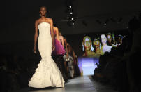 A model displays an outfit by designer Frank Osodi of Nigeria at the ARISE Fashion Week event in Lagos, Nigeria on Sunday, March 11, 2012. (AP Photos/Sunday Alamba)