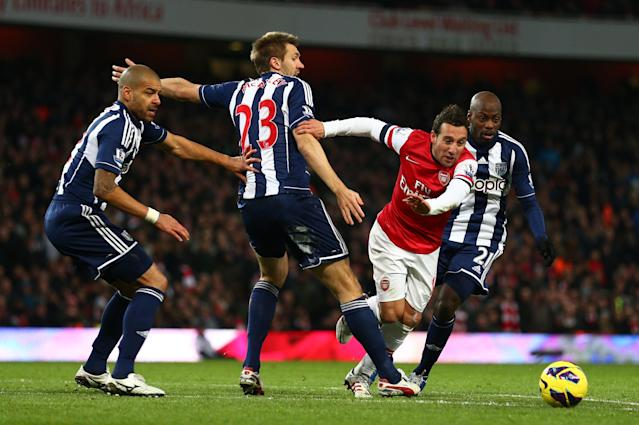 LONDON, ENGLAND - DECEMBER 08: Santi Cazorla of Arsenal is closed down by Steven Reid, Gareth McAuley and Youssuf Mulumbu of West Bromwich Albion during the Barclays Premier League match between Arsenal and West Bromwich Albion at Emirates Stadium on December 8, 2012 in London, England. (Photo by Clive Mason/Getty Images)