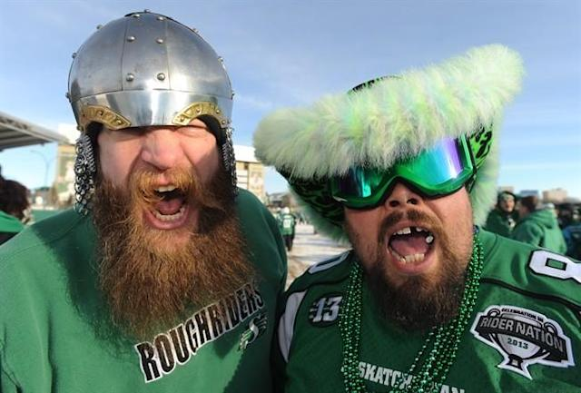 Saskatchewan Roughriders fansBen Bandenberg, left, and Dave Friesen ham it up outside Mosaic Stadium before the Grey Cup game, Sunday, November 24, 2012 in Regina. THE CANADIAN PRESS/Liam Richards