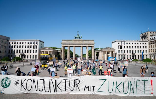Berlin: Fridays for Future activists take part in a demonstration in front of the Brandenburg Gate on 2 June ahead of a government meeting to discuss a coronavirus stimulus package. (Kay Nietfeld/Picture alliance via Getty)