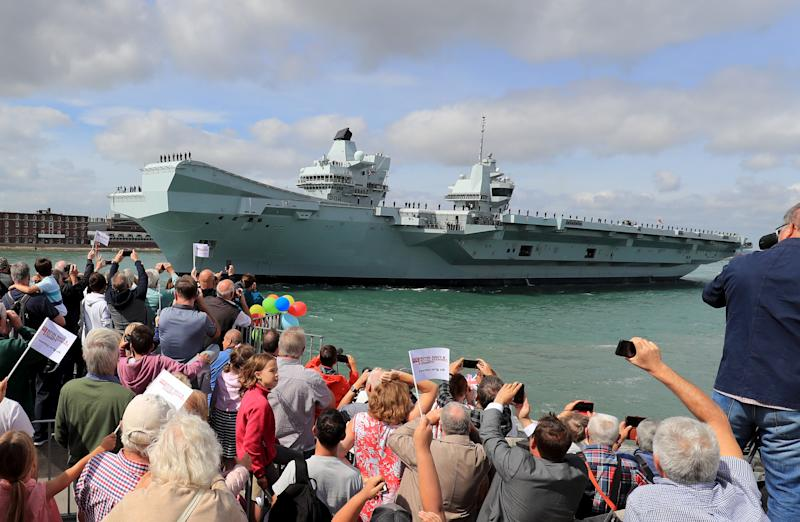 HMS Queen Elizabeth is waved off as she sets sail from Portsmouth Naval Base, for deployment to the United States. (Photo by Gareth Fuller/PA Images via Getty Images)
