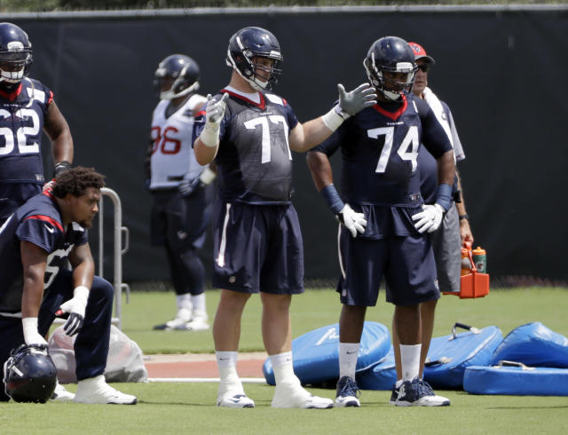 Houston Texans tackle David Quessenberry (C) has been promoted to the team's 53-man roster, over three years after he was diagnosed with cancer. (AP)