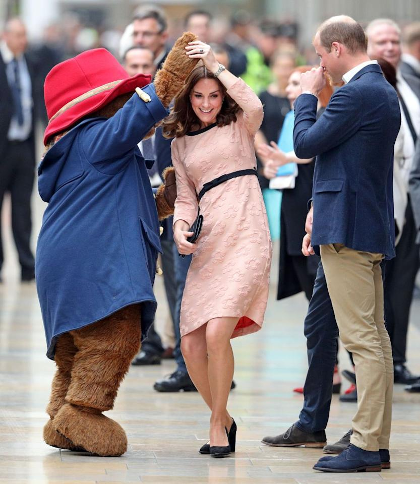 <p>Paddington Bear spins the Duchess of Cambridge during the Charities Forum Event at Paddington Station.</p>