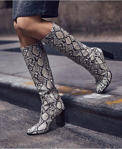 """<p>Own the snakeskin trend in these <a href=""""https://www.popsugar.com/buy/Kenneth-Cole-New-York-Justin-Block-Heel-Tall-Boots-500922?p_name=Kenneth%20Cole%20New%20York%20Justin%20Block-Heel%20Tall%20Boots&retailer=macys.com&pid=500922&price=119&evar1=fab%3Aus&evar9=46799976&evar98=https%3A%2F%2Fwww.popsugar.com%2Ffashion%2Fphoto-gallery%2F46799976%2Fimage%2F46799978%2FKenneth-Cole-New-York-Justin-Block-Heel-Tall-Boots&list1=shopping%2Cfall%20fashion%2Cshoes%2Cboots%2Cfall%2Cfall%20shoes%2Cmacys&prop13=mobile&pdata=1"""" rel=""""nofollow"""" data-shoppable-link=""""1"""" target=""""_blank"""" class=""""ga-track"""" data-ga-category=""""Related"""" data-ga-label=""""https://www.macys.com/shop/product/kenneth-cole-new-york-womens-justin-block-heel-tall-boots?ID=5495819&amp;CategoryID=25122"""" data-ga-action=""""In-Line Links"""">Kenneth Cole New York Justin Block-Heel Tall Boots</a> ($119, originally $199).</p>"""