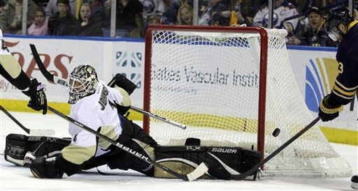 Pittsburgh Penguins goalie Brent Johnson makes a save on a shot by Buffalo Sabres' Ville Leino (23) during the first period of an NHL hockey game in Buffalo, N.Y., Friday, March 30, 2012. (AP Photo/David Duprey)