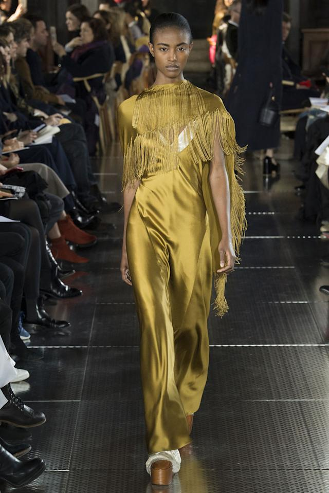 <p>Gabriela's gold fringe dress in the most exquisite silk. (Photo: Getty Images) </p>