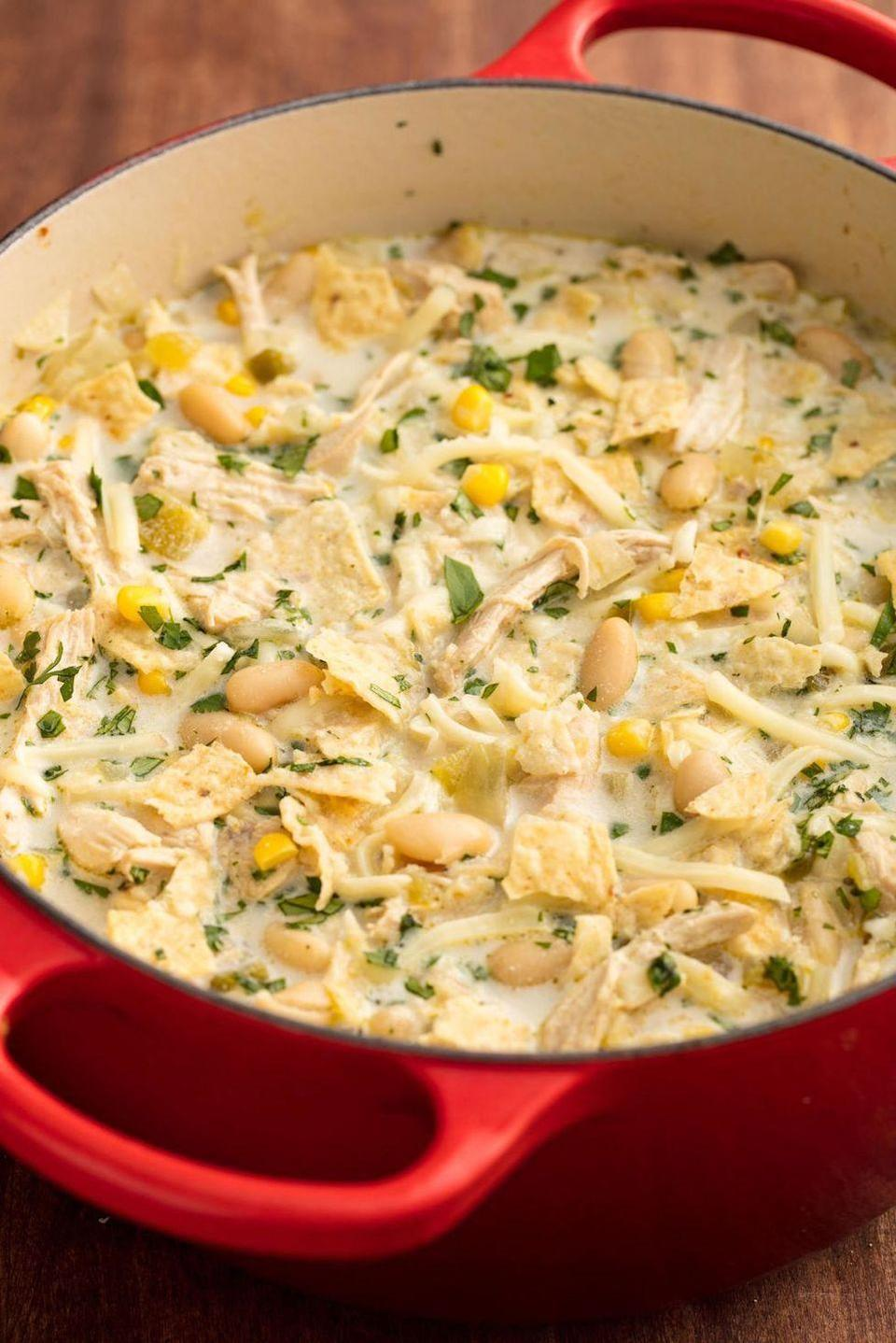 "<p>This chili is full of the good stuff: sour cream<em> and </em>cheese. </p><p><em><a href=""https://www.delish.com/cooking/recipe-ideas/recipes/a57946/easy-white-chicken-chili-recipe/"" rel=""nofollow noopener"" target=""_blank"" data-ylk=""slk:Get the recipe from Delish »"" class=""link rapid-noclick-resp"">Get the recipe from Delish »</a></em></p>"