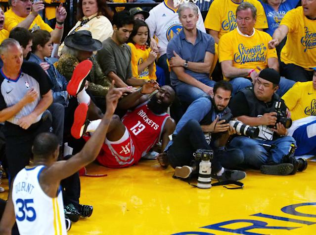 May 20, 2018; Oakland, CA, USA; Houston Rockets guard James Harden (13) falls into the fans behind Golden State Warriors forward Kevin Durant (35) during the second quarter in game three of the Western conference finals of the 2018 NBA Playoffs at Oracle Arena. Mandatory Credit: Kelley L Cox-USA TODAY Sports TPX IMAGES OF THE DAY