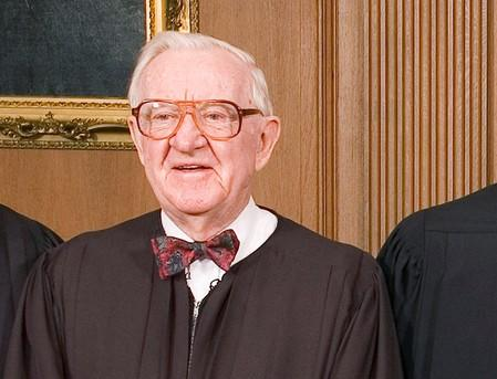 FILE PHOTO:  Justice John Paul Stevens in the Chief Justice's Conference Room at the Supreme Court in Washington