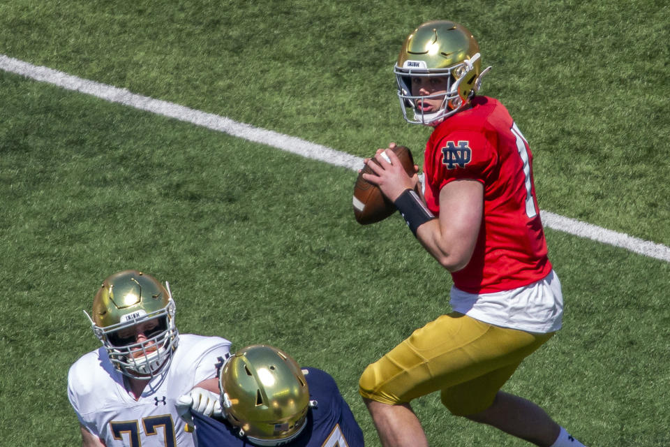 FILE - In this May 1, 2021, file photo, Notre Dame quarterback Jack Coan (17) looks to pass during the Blue-Gold NCAA spring football game in South Bend, Ind. Offensive coordinator Tommy Rees has seen the offense come together behind quarterback Jack Coan, a grad transfer from Wisconsin, and preseason All-American candidates in running back Kyren Williams, tight end Michael Mayer, center Jarrett Patterson and guard Cain Madden, another grad transfer.(AP Photo/Robert Franklin, File)