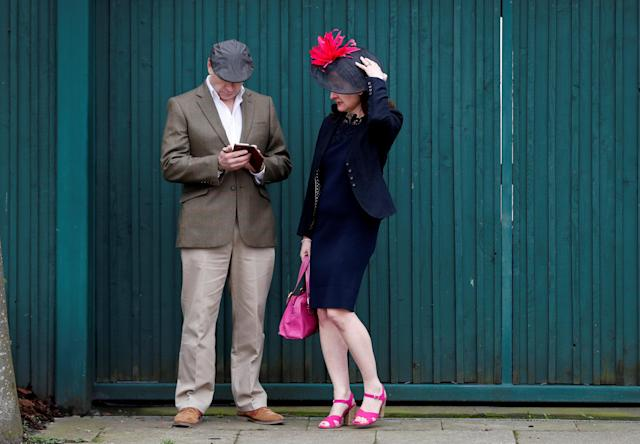 Horse Racing - Grand National Festival - Aintree Racecourse, Liverpool, Britain - April 12, 2018 Racegoers wait to enter before the start of the races REUTERS/Darren Staples