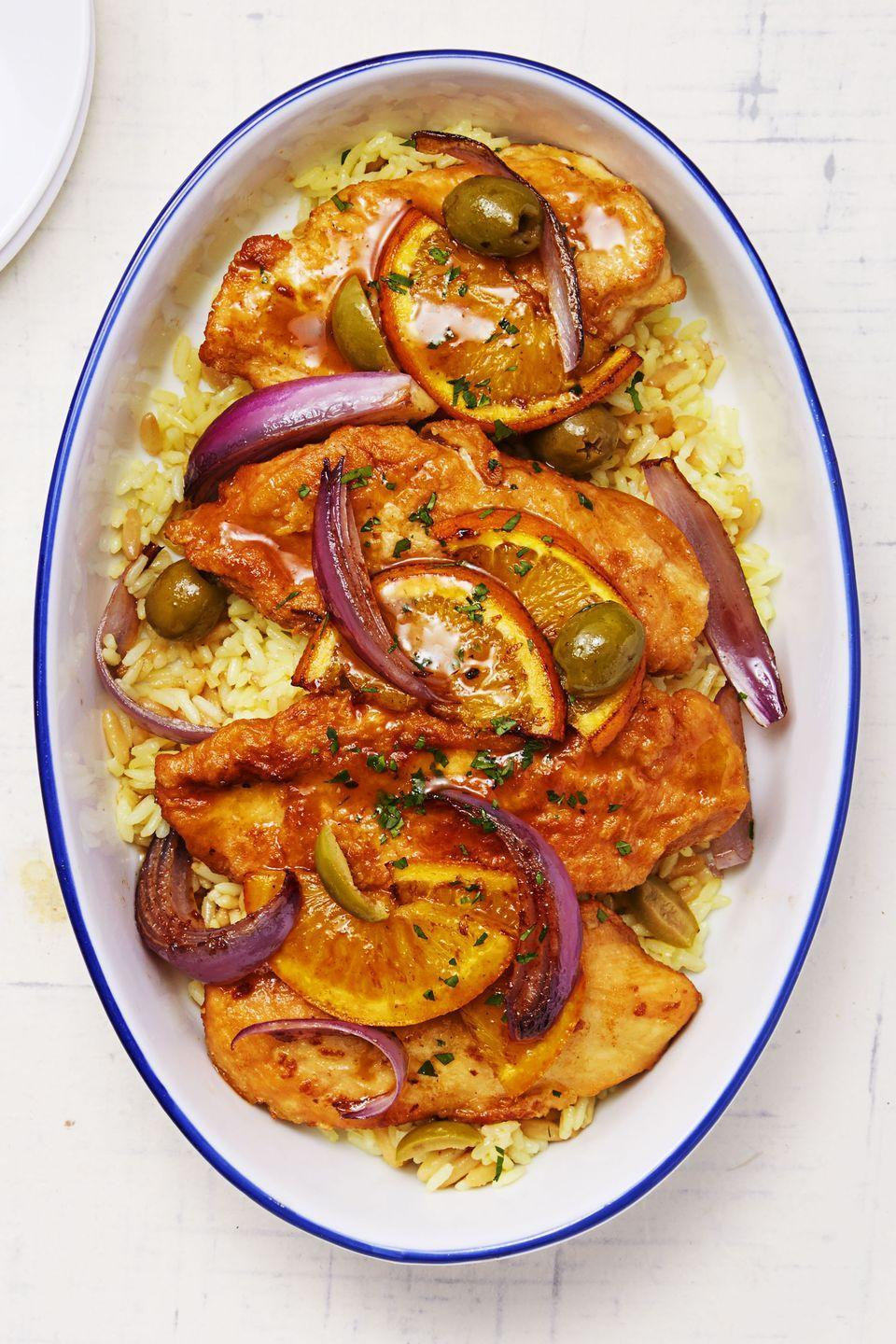 "<p>Boring ol' chicken? No more. Cook the cutlets with navel oranges, red onions and olives for an update your guests will adore. </p><p><em><a href=""https://www.goodhousekeeping.com/food-recipes/a32683/moroccan-olive-and-orange-chicken/"" rel=""nofollow noopener"" target=""_blank"" data-ylk=""slk:Get the recipe for Moroccan Olive and Orange Chicken »"" class=""link rapid-noclick-resp"">Get the recipe for Moroccan Olive and Orange Chicken »</a></em> </p>"