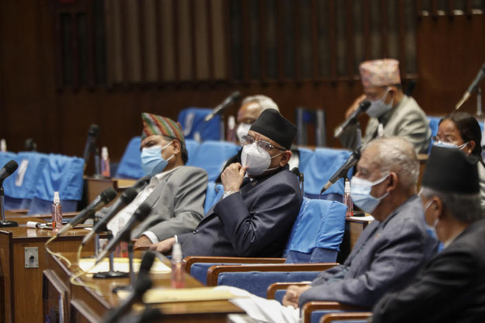 Pushpa Kamal Dahal, leader of the splinter group in the governing Nepal Communist Party attends a meeting of the parliament in Kathmandu, Nepal, Monday, May 10, 2021. Nepal's prime minister asked parliament for a vote of confidence on Monday in an attempt to show he still has enough support to stay in power despite an expected second split within his governing party. (AP Photo/Niranjan Shrestha)